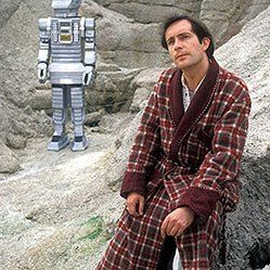 Simon Jones as Arthur Dent with Marvin in the background