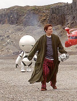 Martin Freeman as Arthur Dent with Marvin in the background