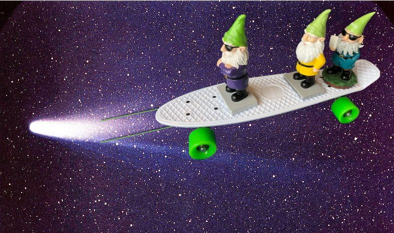 Three Meraki gnomes riding a Meraki skateboard hitched to a comet